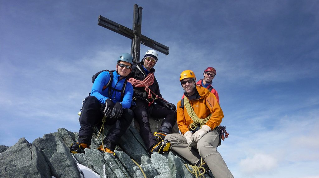 on the summit of the Allalinhorn - classic swiss 4000m peaks mountaineering holiday