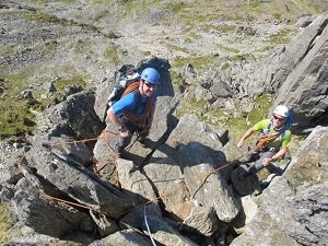 practicing ropework on a north wales scrambling course